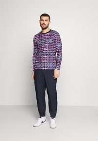 Nike Performance - PANT - Pantalones deportivos - obsidian/white - 1