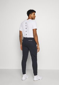Tommy Hilfiger - CUFF JOGGER - Tracksuit bottoms - blue - 2
