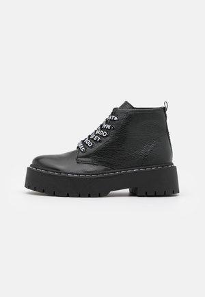 VLAIS - Platform ankle boots - black