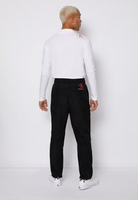 Calvin Klein Jeans - SEAMED PANT - Trousers - black - 2