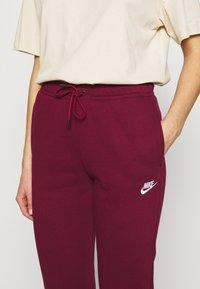 Nike Sportswear - Tracksuit bottoms - dark beetroot - 4