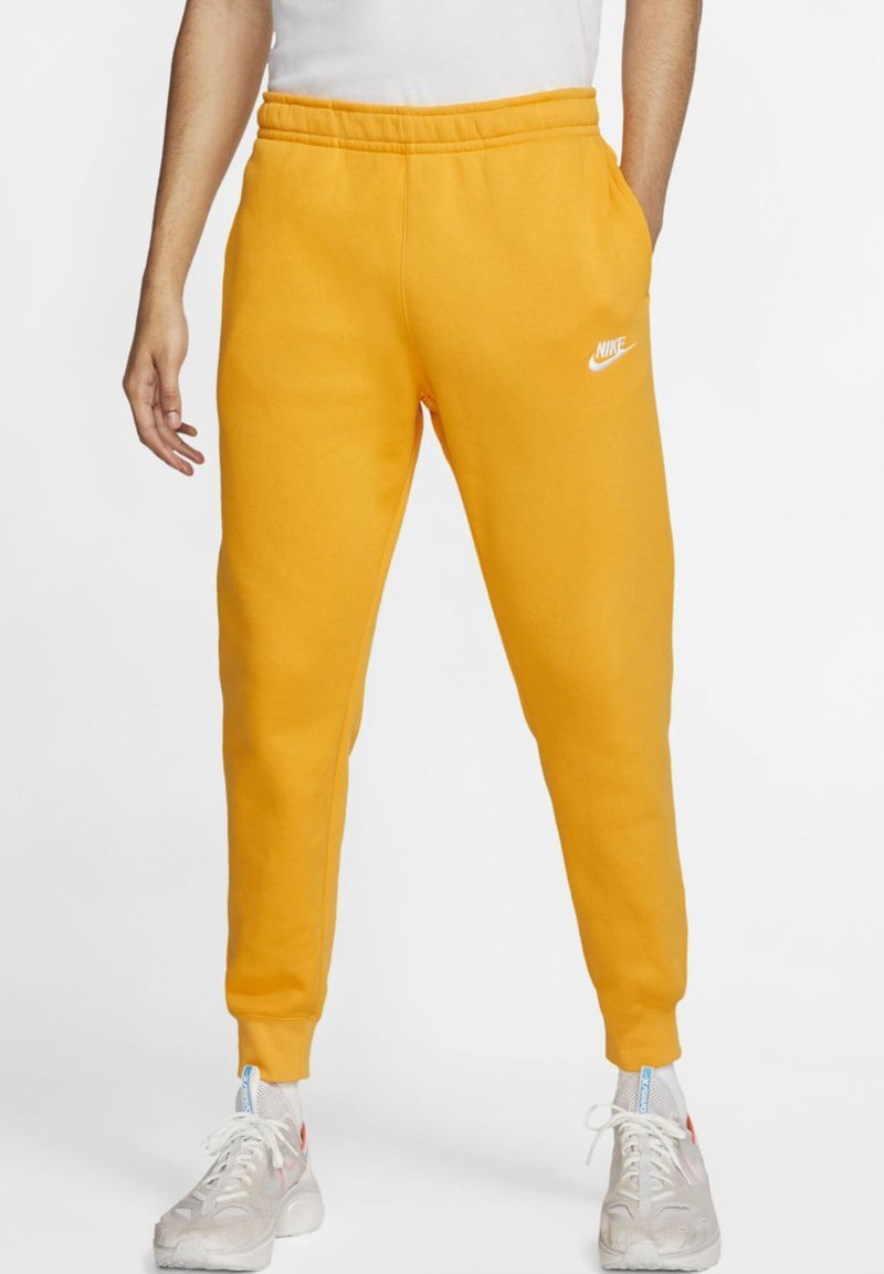 Nike Sportswear - CLUB - Tracksuit bottoms - university gold/white