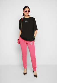 Versace Jeans Couture - PANTS - Tracksuit bottoms - pink - 4