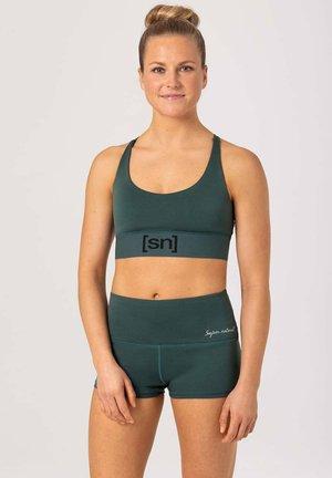 MERINO - Light support sports bra - dunkelgrün
