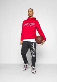 Jordan - AIR THERMA PANT - Teplákové kalhoty - black/white - 1