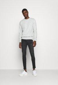 11 DEGREES - ABRASION SUPER SKINNY - Slim fit jeans - black - 1