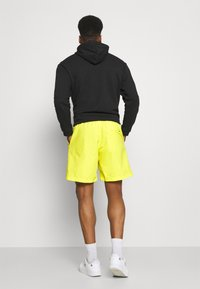 adidas Originals - WOVEN UNISEX - Shorts - acid yellow - 2
