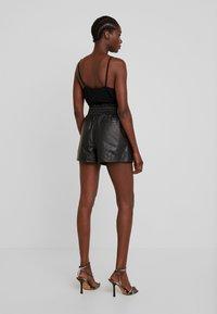 Ibana - FEAST - Leather trousers - black - 2
