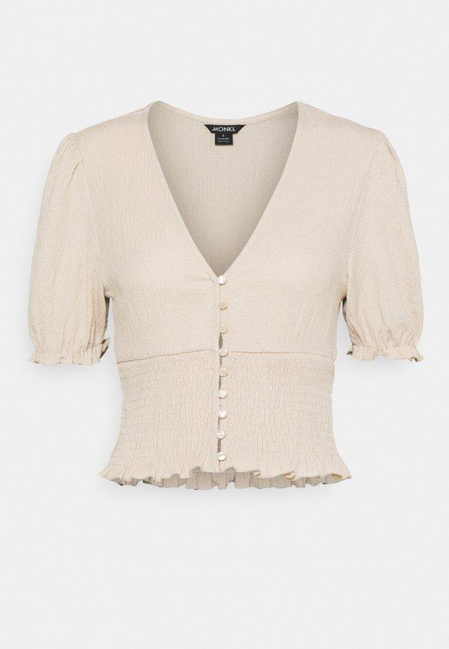 ZANJA - T-shirt med print - beige