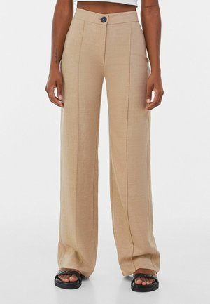 LOOSE-FITTING WIDE-LEG - Trousers - camel