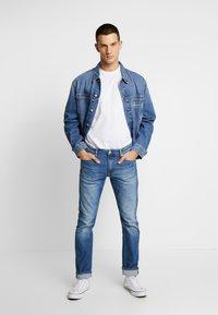 Calvin Klein Jeans - CKJ 026 SLIM - Slim fit jeans - bright blue - 1