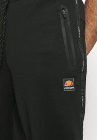 Ellesse - ROMFORD - Pantalones deportivos - black - 4