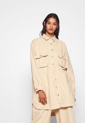 OVERSIZED DRESS - Košilové šaty - cream