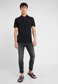 HUGO - DYLER - Polo shirt - black - 1