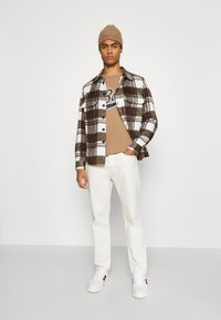 BOSS - BOSS X RUSSELL ATHLETIC - T-Shirt print - medium beige - 1