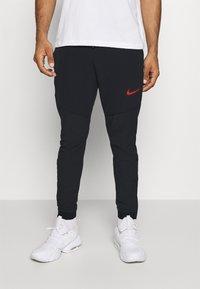 Nike Performance - FLEX PANT  - Tracksuit bottoms - black - 0