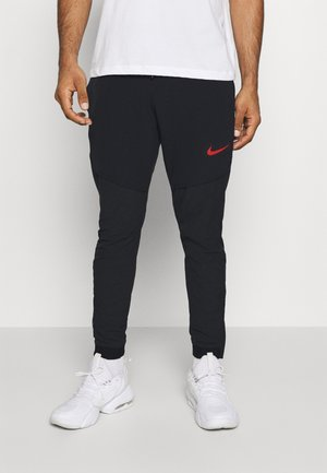 FLEX PANT  - Tracksuit bottoms - black