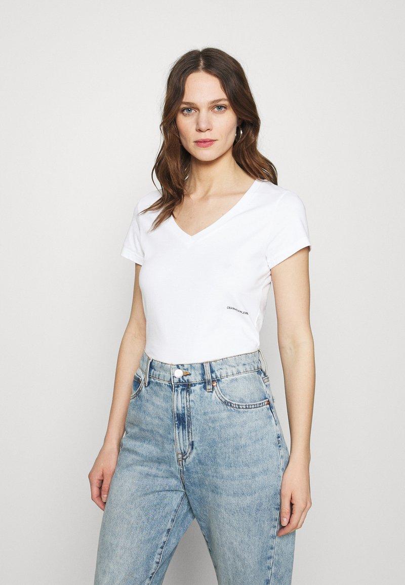 Calvin Klein Jeans - MICRO BRANDING OFF PLACED VNECK - Basic T-shirt - bright white