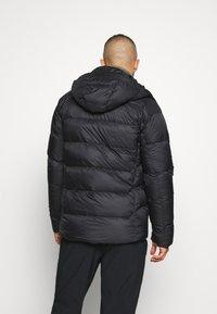 Mammut - MERON IN HOODED JACKET MEN - Down jacket - black - 2