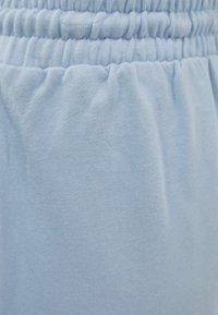 Bershka - MIT PRINT - Tracksuit bottoms - dark blue - 5