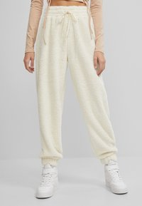 Bershka - Tracksuit bottoms - white - 0