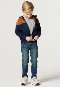 Noppies - BOOSTER - Sweater met rits - black iris - 0