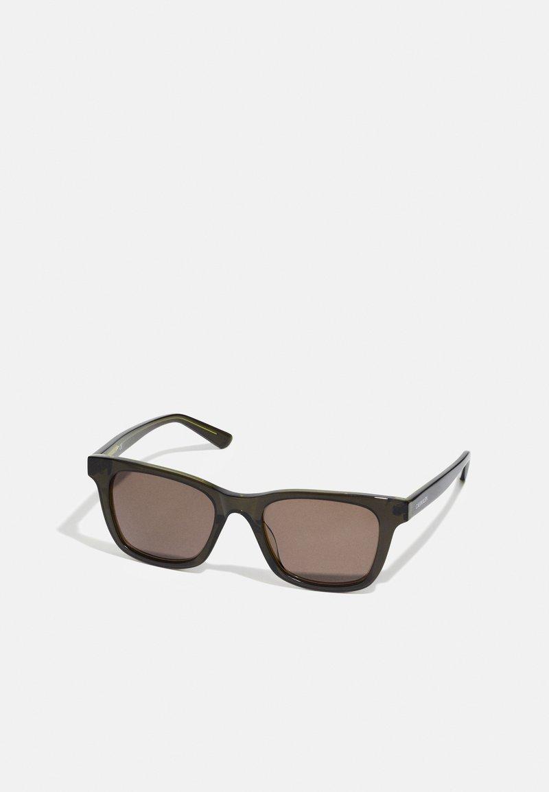 Calvin Klein - UNISEX - Sunglasses - olive/moss