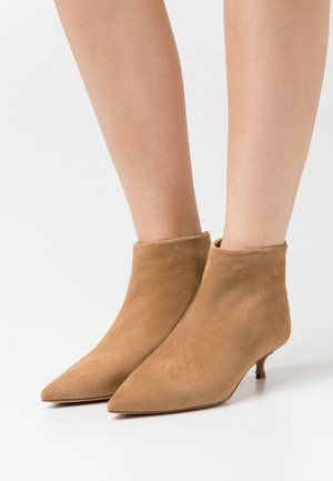 Ankle boots - montone