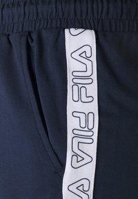 Fila - JADIANA TAPED SHORTS - Pantalón corto de deporte - black iris - 5