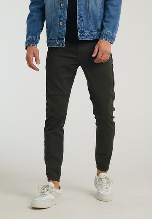 CARGO PANTS - Trousers - green