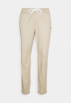 ELASTIC CUFF PANTS - Träningsbyxor - beige