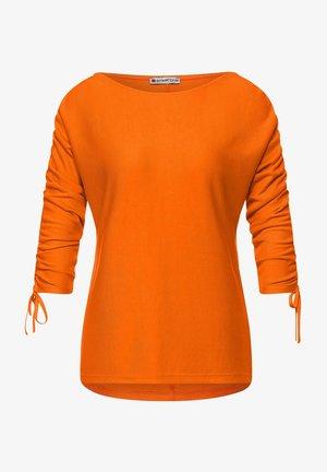 MIT RAFFUNGEN - Blouse - orange