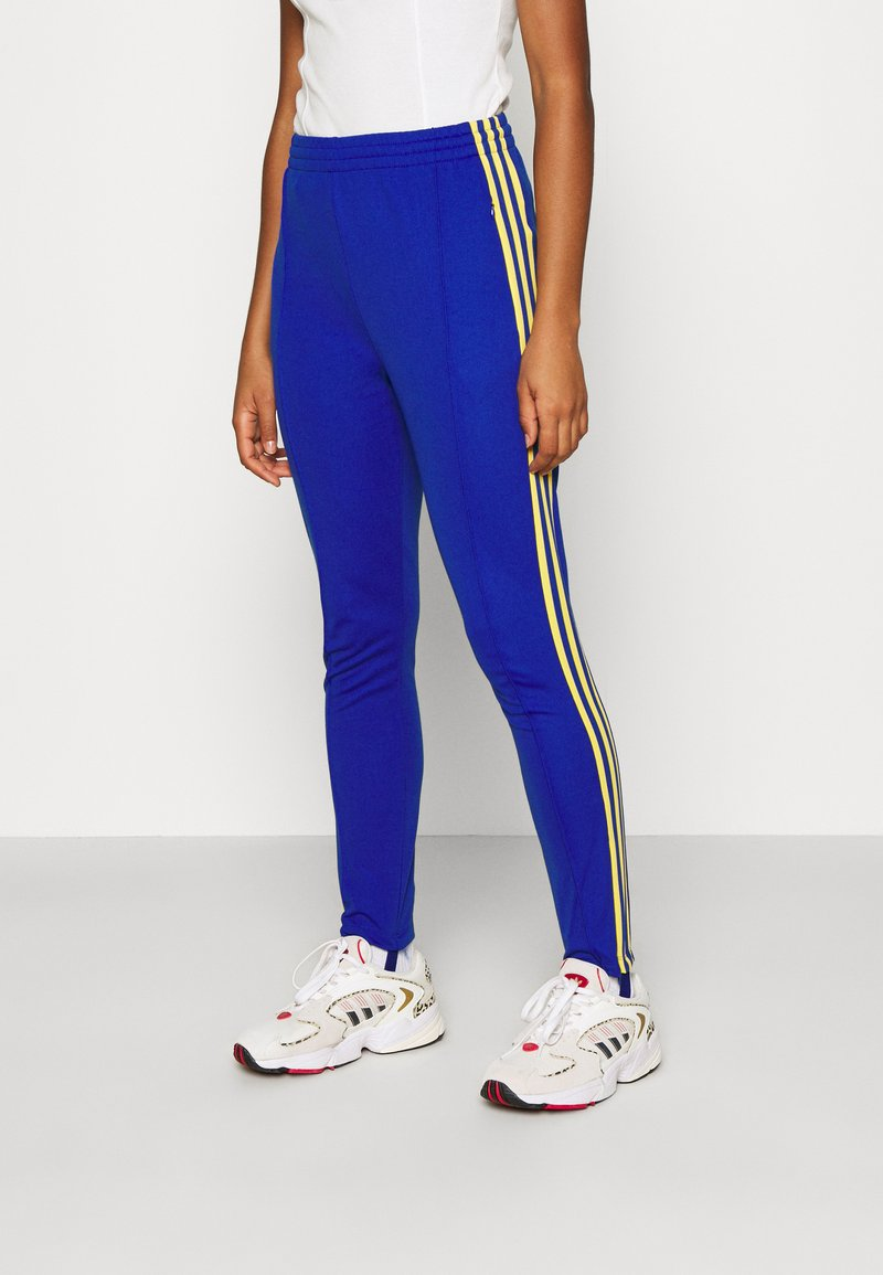 adidas Originals - 70S PANT - Leggings - Trousers - active gold/team royal blue