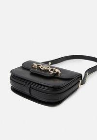 Guess - HENSELY MINI XBDY FLAP - Across body bag - black - 3