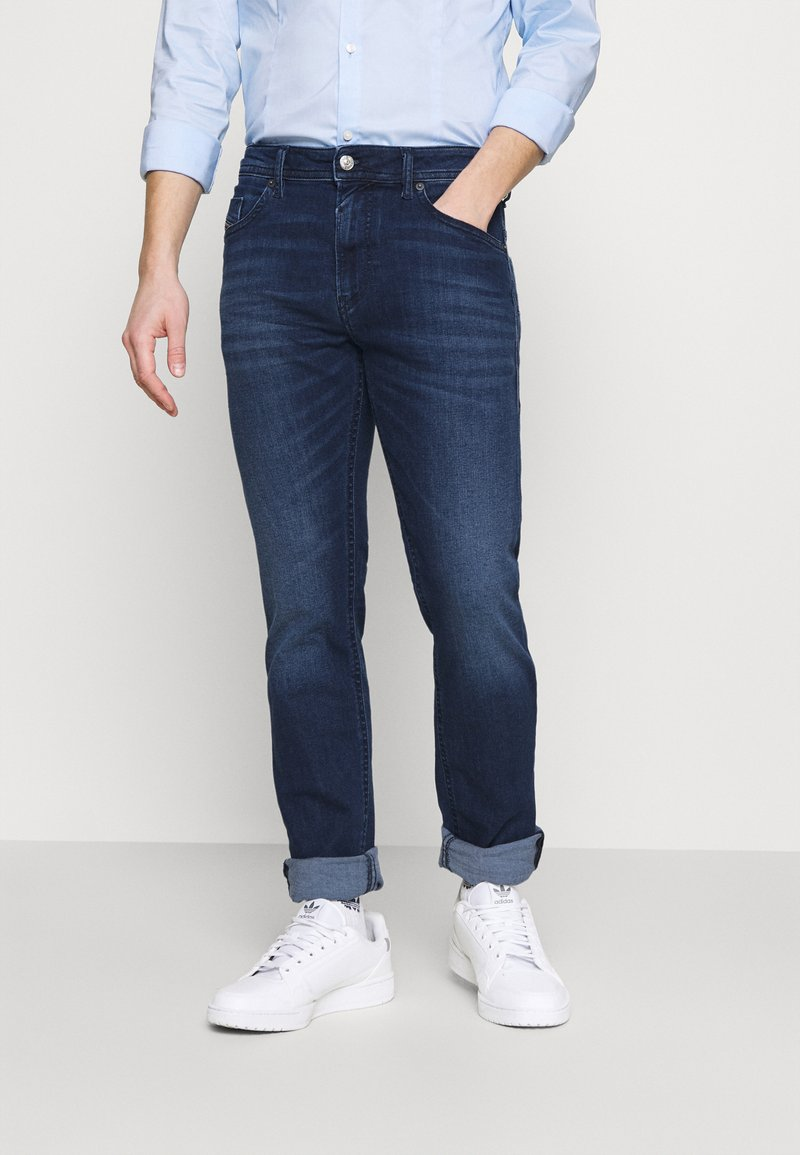 Diesel - THOMMER - Slim fit jeans - dark blue