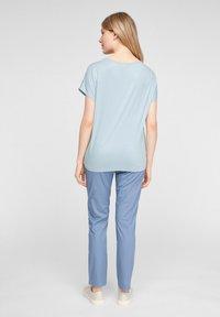 s.Oliver - Print T-shirt - light blue aop - 2