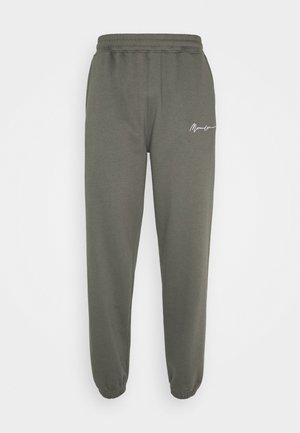 ESSENTIAL JOGGER UNISEX - Tracksuit bottoms - washed black