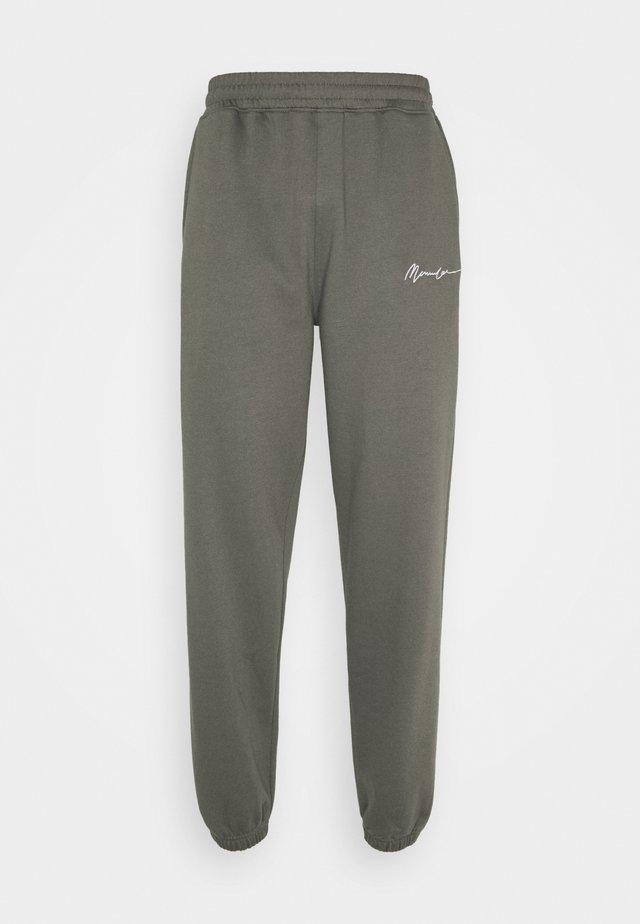 ESSENTIAL JOGGER UNISEX - Teplákové kalhoty - washed black
