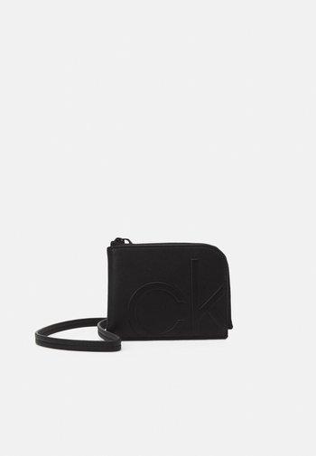ZIPAROUND WALLET UNISEX - Wallet - black