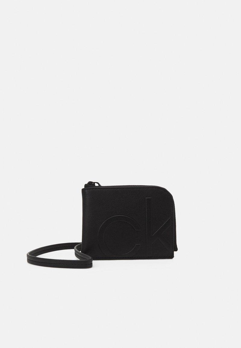 Calvin Klein - ZIPAROUND WALLET UNISEX - Wallet - black