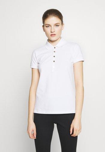 ATHLEISURE  - Poloshirt - white