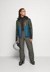 Mons Royale - ARETE INSULATION HOOD - Outdoor jacket - atlantic/rosin - 1