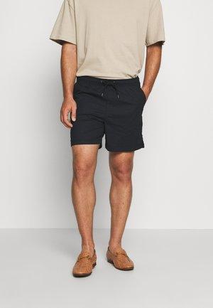 GUBI ELASTIC - Shorts - black
