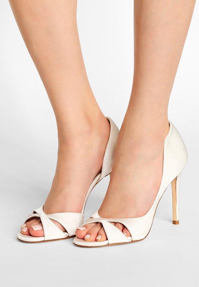 Peeptoe heels - seda goya bone