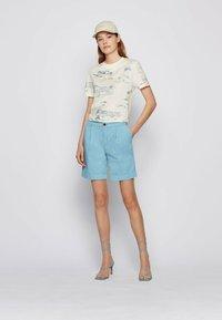 BOSS - TAGGIE - Shorts - light blue - 1