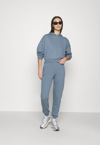 NU-IN - FIT - Tracksuit bottoms - blue - 1