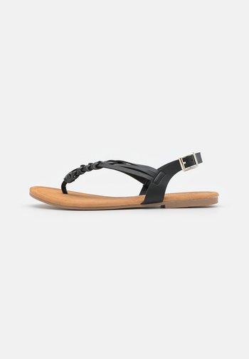 PLAITED - T-bar sandals - black