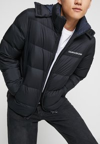 Calvin Klein Jeans - HOODED DOWN PUFFER  - Winter jacket - black - 4