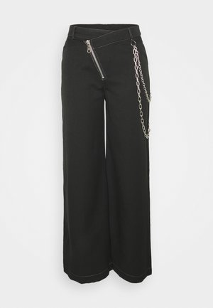 DROPOUT PANT - Trousers - black
