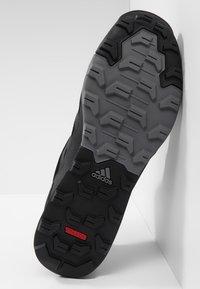 adidas Performance - TERREX TIVID MID CLIMAPROOF HIKING SHOES - Obuwie hikingowe - black - 4